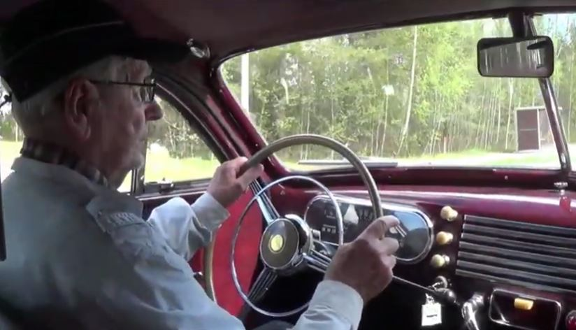 Oldtimer Driving a Checker